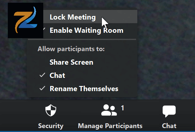 لقطة شاشة لمؤشر الماوس يحوم فوق خيار Lock Meeting في تطبيق Zoom.